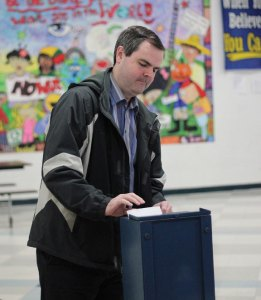 Paul Cummings, of Beacon Falls, casts his ballot on the sale of Community School during a Region 16 district meeting March 23 at Long River Middle School in Prospect. Voters approved selling the school to Prospect. –ELIO GUGLIOTTI