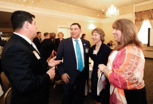From left, Marcelo Martins, Stephen Pretto, Susan Frumerie and United Way of Naugatuck & Beacon Falls Executive Director Lisa Shappy chat during the United Way's annual meeting at the Crystal Room in Naugatuck March 24. -REPUBLICAN-AMERICAN