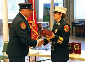 Retired Naugatuck Firefighter Leonard Patterson receives a retirement gift from interim Fire Chief Ellen Murray March 30 at St. Francis Church hall during the Board of Fire Commissioners' fifth annual Employee Recognition Ceremony. Patterson retired from the department after 25 years. –LUKE MARSHALL