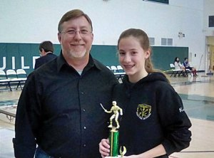 Rebekah Wallace, of Prospect, right, won a silver medal in Novice Girls Epee at the Novice tournament Feb 6. She is pictured with Prospect Fencing Club coach Bob Rosa. –CONTRIBUTED