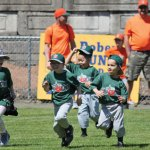 Players on the Peter J. Foley Little League Tincaps run out after being announced during the Little League's opening day ceremony April 17 in Naugatuck. –ELIO GUGLIOTTI