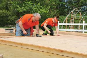 Daniel Orsatti, left, and Jen Fillion, volunteers from Home Depot, help build a barn for the Kelly's Kids in Prospect on May 20. Volunteers from Home Depot and the Ion Bank Foundation in Naugatuck worked to build a barn and chicken coop to help the nonprofit organization get ready for its first summer camp in July. –LUKE MARSHALL