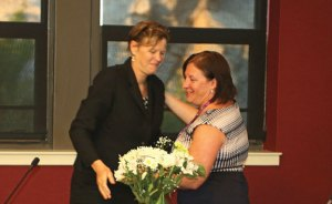 Naugatuck Superintendent of Schools Sharon Locke, left, gives former Board of Education member Jill Mahoney a hug after presenting her with flowers July 14. Mahoney officially tendered her resignation and stepped down from the board that evening. –LUKE MARSHALL
