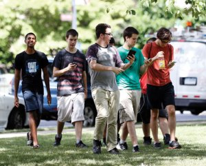 People gather at the Naugatuck Green to play Pokemon Go on Monday. –REPUBLICAN-AMERICAN
