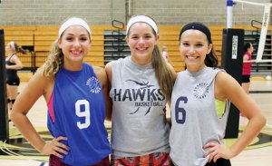 Woodland seniors and volleyball captains, from left, McKenna Cronin, Maddie Hupprich and Katie Minutillo will lead the Hawks on the court this season. –ELIO GUGLIOTTI