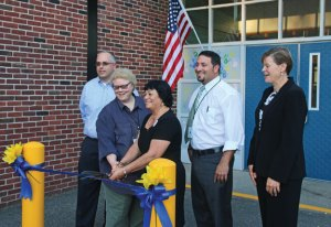 Naugatuck Early Childhood Education Coordinator Giocomina Bacon, front right, cuts a ribbon with Board of Education Chair Dorothy Neth-Kunin as board members, back row from left, Glenn Connan and Jason Celozzi and Superintendent of Schools Sharon Locke look on during a ceremony Sept. 22 at the Early Childhood Center at Central Avenue. –LUKE MARSHALL