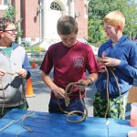 Boy Scouts, from left, Lucas Patino, 13, Robbie Fanzutti, 13, Nate Gairing, 13, all with Troop 102, demonstrate how to tie knots during the Harvest Moon Festival on the Naugatuck Green Sept. 17. –LUKE MARSHALL