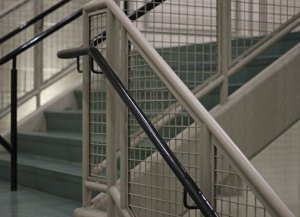 Region 16 officials will have to reduce the space between the hand railings and what they are attached to at Woodland Regional High School following a random facility review by the Office for Civil Rights. –ELIO GUGLIOTTI
