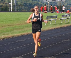 Woodland's Emilie Noreika heads toward the finish line during a meet Tuesday versus Crosby, Torrington and Wolcott in Beacon Falls.–LUKE MARSHALL