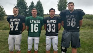 Woodland seniors and football captains, from left, Scott Lawrence, Quincy Koch, Issac Negron and Cody Doyle will lead the Hawks this season. –ANDREW SHURRETTO