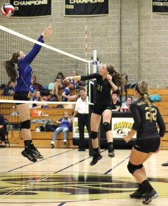 Woodland's Emily Brouilette (31) goes for the kill versus St. Paul Sept. 29 in Beacon Falls. Woodland won, 3-0. –ELIO GUGLIOTTI