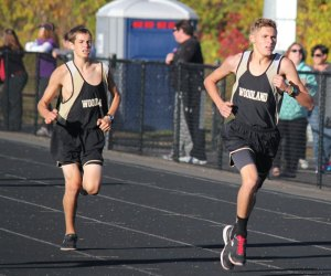 Woodland's Matt Luxeder, right, and Vinnie Costanzo keep up the pace Oct. 11 during a meet with Sacred Heart, Holy Cross and Derby in Beacon Falls. –ELIO GUGLIOTTI