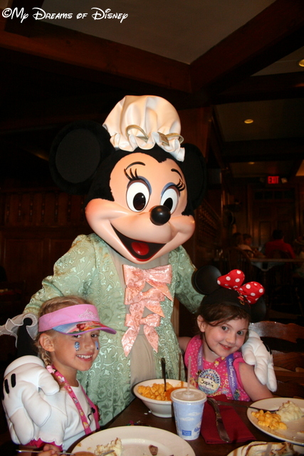 Sophie and Riley posing with Minnie Mouse at the Liberty Tree Tavern.