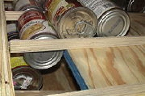 180px-Shelf_blocked_cans_49