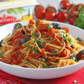 A super delicious and fresh pasta sauce made with Bertolli spread and packed with classic Italian flavours from tomatoes, garlic, capers, anchovies and olives. Really easy to make and sure to be a family hit!