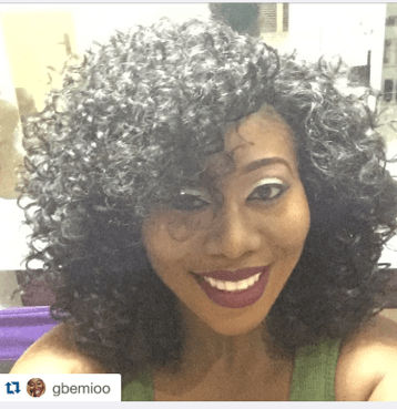 Radio personality Gbemi rocks beautiful curls with Bold lips.