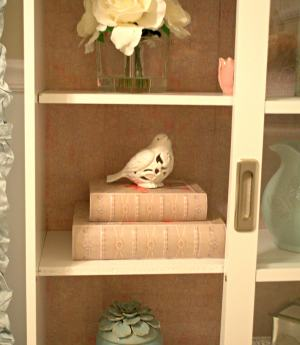 Lining a Bookshelf with Scrapbook Paper