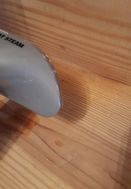 use steam iron to soften adhesive