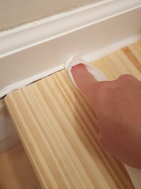 smooth caulk with your finger