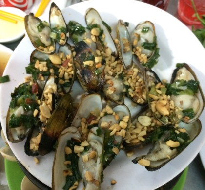 Fire roasted fur clams with green onions and peanuts