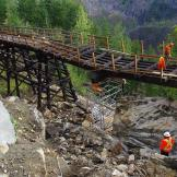 Workers prepare Trestle #3 for partial disassemble during the reconstruction process.Photo by Dave Richmond, BC Parks.(click image to enlarge)