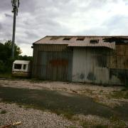 The burnt out building on the former Forshaws site