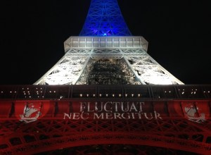 Eiffel tower lit in flag colours