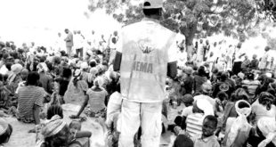A National Emergency Management Agency official at an IDP camp in Adamawa State