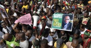 pro-biafra-supporters-carry-poster-nnamdi-kanu-protest-aba-nigeria.