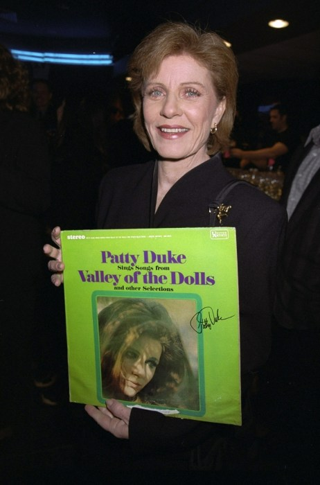 Patty Duke holds her album at the American Movie Classics' s