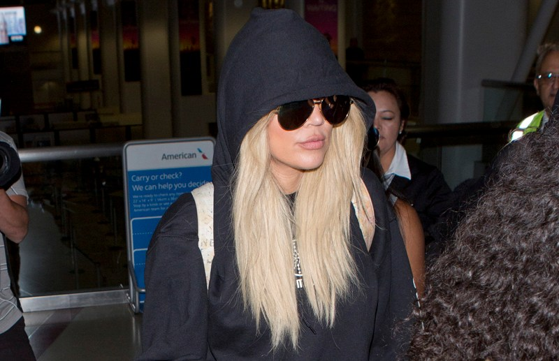 Khloe Kardashian wearing a Black Hoodie, Sunglasses and fluffy slippers along with her best friend Malika were seen arriving into LAX on a flight from New York City  Pictured: Khloe Kardashian Ref: SPL1359682  220916   Picture by: SPW / Splash News  Splash News and Pictures Los Angeles:	310-821-2666 New York:	212-619-2666 London:	870-934-2666 photodesk@splashnews.com