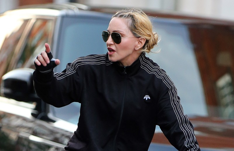 EXCLUSIVE: A low rider Madonna out cycling in London with two personal trainers. The Material Girl singer, 58, wearing Alexander Wang/Adidas Originals top, check trousers which were half way down showing off her perk derriËre and underwear was spotted riding around Hyde Park.   Pictured: Madonna Ref: SPL1355805  130916   EXCLUSIVE Picture by: Gotcha Images / Splash News  Splash News and Pictures Los Angeles:310-821-2666 New York:212-619-2666 London:870-934-2666 photodesk@splashnews.com