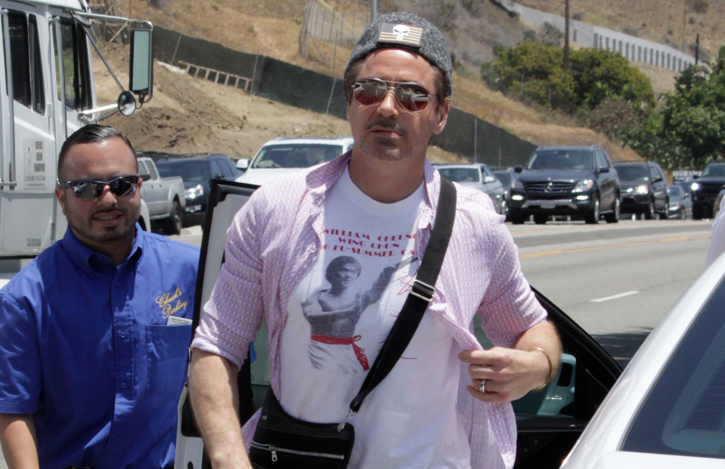 Robert Downey Jr was seen arriving at Joel Silver's annual Memorial Day party in Malibu, California. Robert was accompanied by his son Exton.    Pictured: Robert Downey Jr Ref: SPL1293329  300516   Picture by: Lauren/Mr Photoman/Splash News  Splash News and Pictures Los Angeles:	310-821-2666 New York:	212-619-2666 London:	870-934-2666 photodesk@splashnews.com
