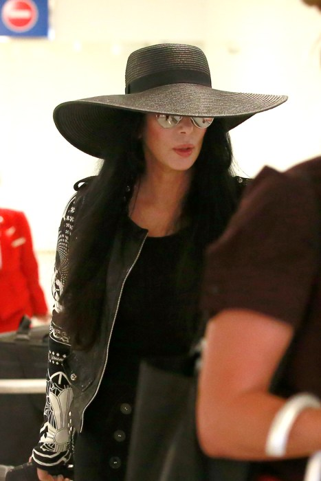 EXCLUSIVE: ****PREMIUM EXCLUSIVE RATES APPLY**** Cher is seen in Los Angeles amidst rumors she's dying, broke & alone. The music legend is seen at LAX with sunglasses & a floppy hat after spending some time in the South of France.