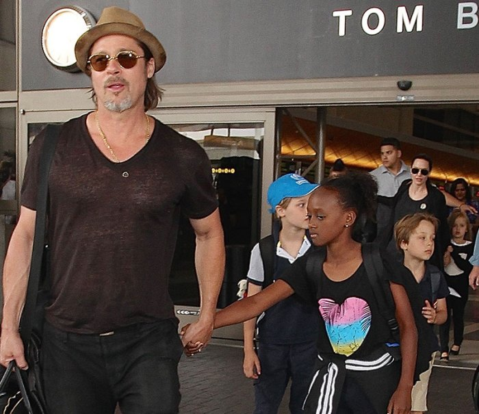 Brad Pitt and Angelina Jolie arriving on a flight at LAX with their children