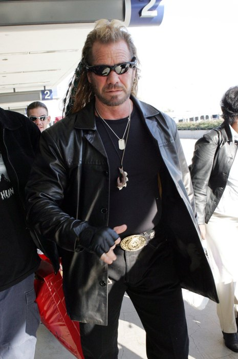 EXCLUSIVE: Dog Duane Lee Chapman walks around the departures side walk at LAX.