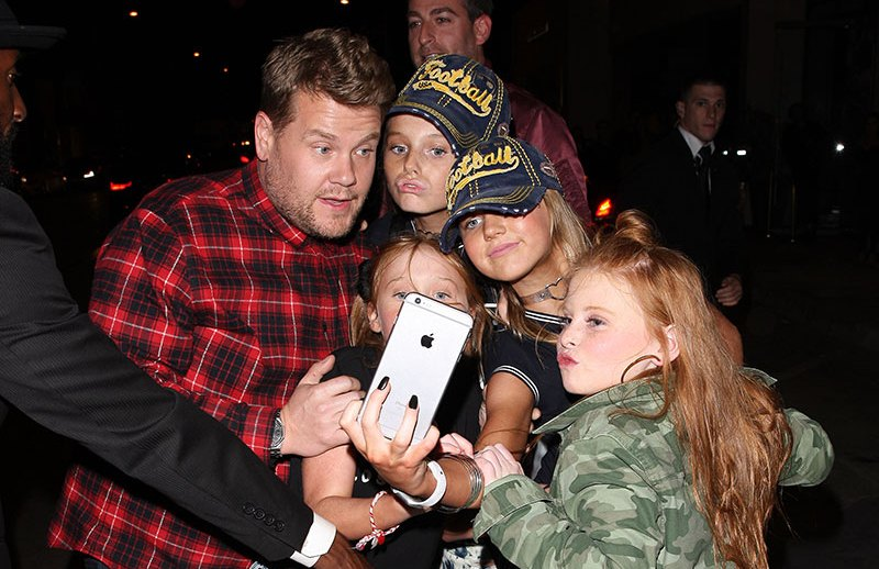 James Corden poses with young fans as he dines at Catch restaurant in West Hollywood, Los Angeles, CA, USA.   Pictured: James Corden Ref: SPL1381975  261016   Picture by: Photographer Group / Splash News  Splash News and Pictures Los Angeles:310-821-2666 New York:212-619-2666 London:870-934-2666 photodesk@splashnews.com