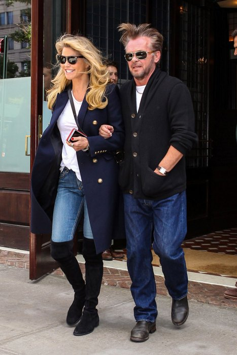 Christie Brinkley and new boyfriend John Mellencamp leave their hotel arm in arm