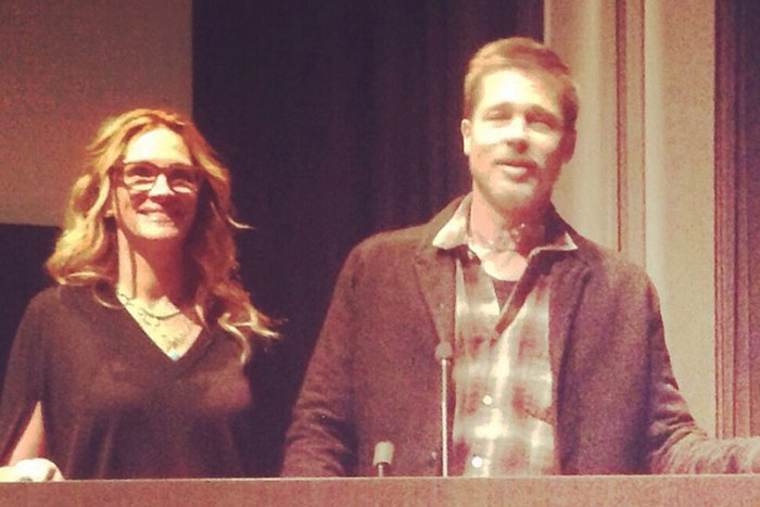 Brad Pitt appears strained and thinner as he attends a Los Angeles movie screening with Julia Roberts