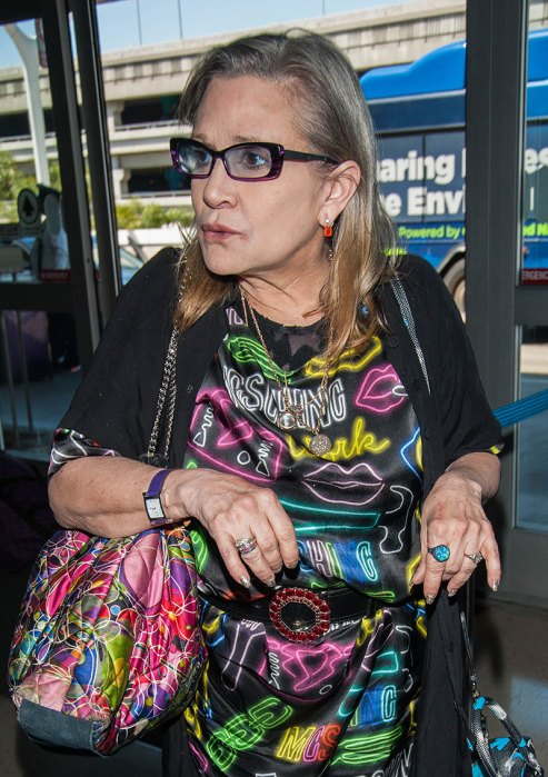 EXCLUSIVE: File Photos-Actress Carrie Fisher with dog Gary at LAX airport kisses driver goodbye in April 2016