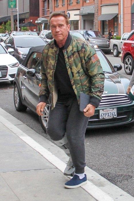 Arnold Schwarzenegger sports foot brace in the 90210