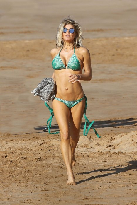 *PREMIUM EXCLUSIVE* Fergie shows her bikini body as she continues family beach holiday