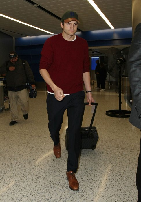 EXCLUSIVE: Ashton Kutcher arrives back home just hours from D.C. from the Foreign Relations hearing