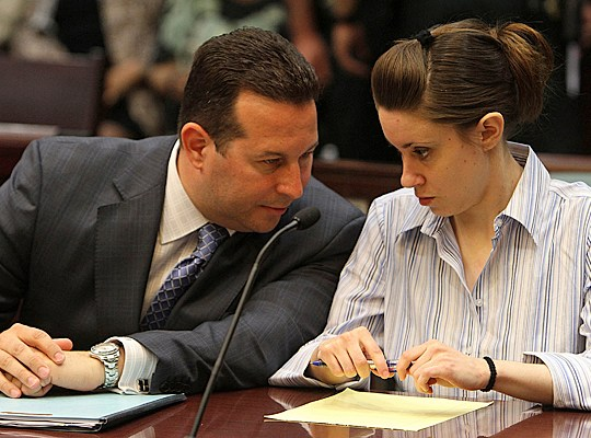 Attorney Jose Baez, left, and his client Casey Anthony confer during a pre-trial hearing, Friday, April 15, 2011, at the Orange county courthouse in Orlando, Florida. Anthony, 25, and her defense team are back in court this afternoon, where lawyers will argue over mental-health examinations. She is accused of killing 2-year-old daughter Caylee Marie Anthony in 2008. (Red Huber/Orlando Sentinel/MCT via Getty Images)