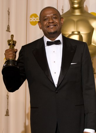 Oscar winner Forrest Whitaker proudly shows off his award