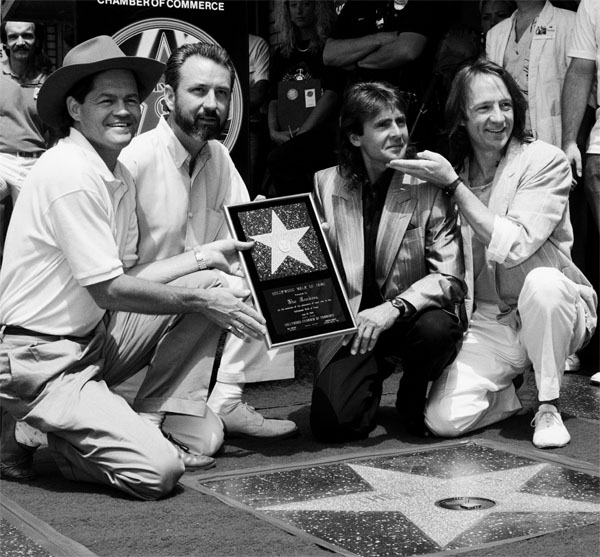 The Monkees get a star on the Hollywood Walk of Fame in 1989.