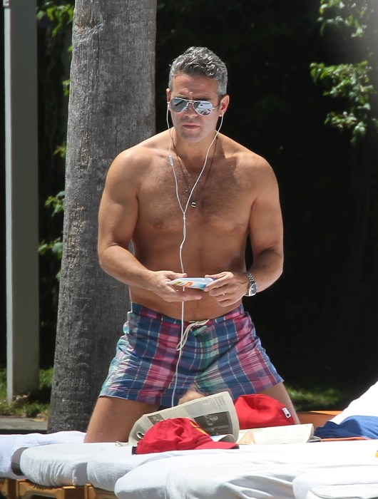 Bravo's Andy Cohen relaxing poolside in Miami Beach.
