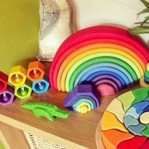 colourful wooden toys on a shelf