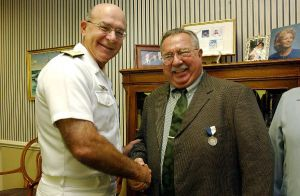 2002: Navy Times senior reporter John Burlage receives the Superior Public Service Award from Adm. Vern Clark, Chief of Naval Operations. (U.S. Navy photo)