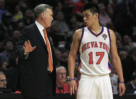 New York Knicks' Jeremy Lin listens to coach Mike D'Antoni during a break in their NBA basketball game against Chicago Bulls in Chicago